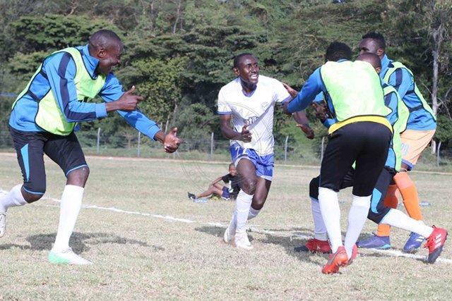 stephen_waruru_celebrates_with_team_mates